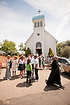 St. Vasilije of Ostrog Serbian Orthodox Church 100th anniversary Divine Liturgy celebration. Prisoners gather at the doorstep at the end of liturgy.
