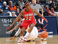 Dec. 6, 2010; Charlottesville, VA, USA; Radford Highlanders guard Da'Naria Erwin-Spencer (22) fights for a loose ball with Virginia Cavaliers guard Whitny Edwards (2) at the John Paul Jones Arena. Virginia won 76-52. Mandatory Credit: Andrew Shurtleff