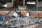 A car lies among the debris strewn across the floor of the sports center where Hideharu Sasaki was almost drowned following the March 11 tsunami in Rikuzebtakata, Iwate Prefecture, Japan on 09 March 2012. Around 100 people died in the sports center.Photographer: Robert Gilhooly.