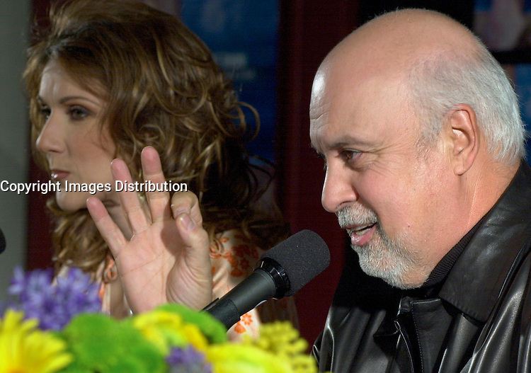 April 03, 2002, Montreal, Quebec, Canada; <br /> <br /> Rene Angelil (R), Celine Dion's husband and manager<br />  talk about Dion's (L) new ballad-heavy album, A New Day Has Come after her two-year break,  during a press conference, April 03, 2002, in Montreal, Canada.<br /> <br /> Her new album is at the number one in 18 countries<br /> <br /> Her husband Rene Angelil finds himself fending off a civil suit alleging assault and sexual battery, that apparently happened two years ago in Las Vegas.