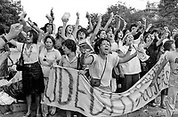 Women, soaked after being targetted by water cannon during a demonstration against dictator General Pinochet, on International Women's Day.