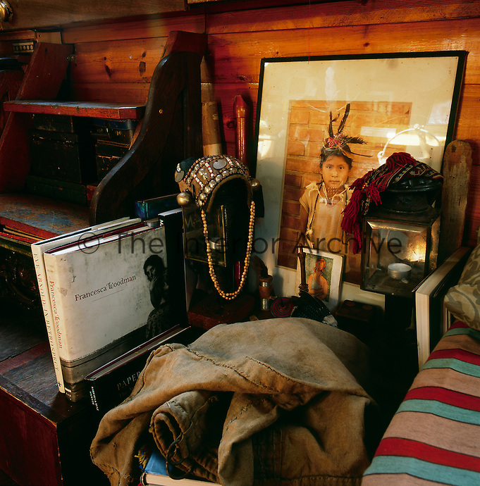A collection of varied and interesting objects is displayed in one corner of the bedroom area