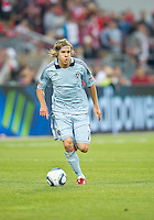 Sporting KC defender/midfielder Chance Myers #7 in action during an MLS game between Sporting Kansas City and the Toronto FC at BMO Field in Toronto on June 4, 2011..The game ended in a 0-0 draw...