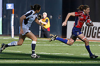 February 14 2009, San Diego, CA, USA:  The IRB USA Sevens Tournament at Petco Park in Downtown San Diego.  A US player breaks away from an English player during the womens final on day one of the tournament.