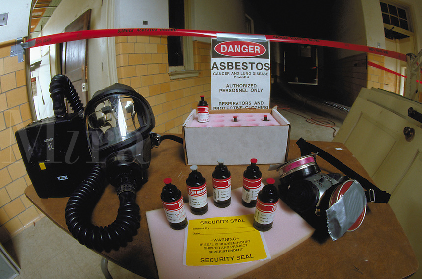 Asbestos monitoring and protective gear at a cleanup site in an old school. Health Hazards, Environment, Protective Gear, Mask, Pollution.