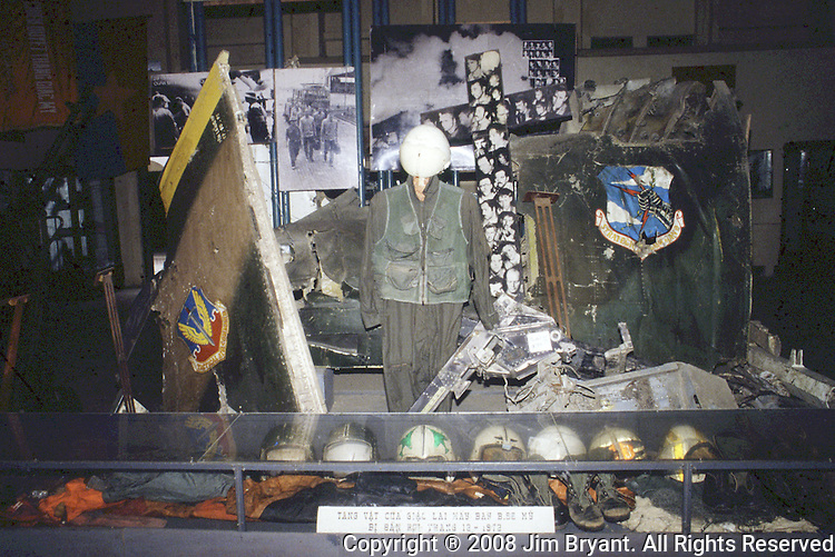 Captured American helmets and pieces of downed aircraft are on display in the museum which houses treasured war trophies from the French and American wars, along with many from the Cambodian and Chinese fronts.In Hanoi, North Vietnam. (Jim Bryant Photo) .....