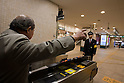 Mar. 11, 2011 - Tokyo, Japan - A frustrated man yells at a train staff at Jiyugaoka Station after a powerful 8.9-magnitude quake hits north-eastern Japan, tsunami feared.