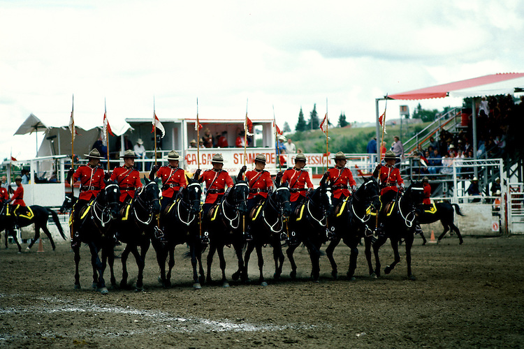 Canada: The Canadian Rockies.  Mounties at the Calgary Stampede.  Photo #: cnrock101..Photo copyright Lee Foster, 510/549-2202, lee@fostertravel.com, www.fostertravel.com.