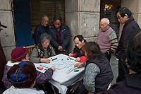 People playing Mah Jongg in the street..Shanghai, February 2006.