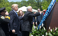 United States President Donald J. Trump and US Vice President Mike Pence place flowers on a memorial wreath at the 36th Annual National Peace Officers' Memorial Service at the US Capitol in Washington, DC, May 15, 2017. <br /> Credit: Chris Kleponis / Pool via CNP /MediaPunch