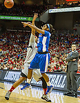UK freshman point guard Janee Thompson manages to get off a pass in the face of Louisville senior forward Monique Reid. UK coach Jeff Walz watches the action from the sideline, momentarily silent after a rough second half for the Cats.  in Louisville, Ky., on Sunday, December, 2, 2012. Photo by James Holt | Staff