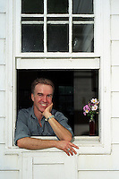 Rob Nixon, professor of english literature and creative writing, leans on the windowsill of his kitchen. Nixon is on sabbatical while he writes an autobiographically-based book about men, masculinity and touch.<br /> <br /> Client: University of Wisconsin-Madison<br /> &copy; UW-Madison University Communications 608-262-0067<br /> Photo by: Michael Forster Rothbart<br /> Date:  08/02     File#:   0207-139c-14a.