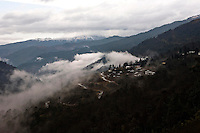 A small village is seen nestled in the mountains on the way to Thimphu, Bhutan.