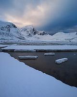 Ice on shoreline at low tide in Flakstadpollen, Flakstadøy, Lofoten Islands, Norway