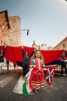 A 4 year old girl in traditional clothing marches in the 11th annual Persian Parade on Madison Ave. in New York on Sunday, April 13, 2014. The parade celebrates Nowruz, New Year in the Farsi language. The holiday symbolizes the purification of the soul and dates back to the pre-Islamic religion of Zoroastrianism. (© Richard B. Levine)