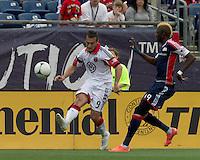 DC United forward Hamdi Salihi (9) passes the ball as New England Revolution forward Saer Sene (39) closes. In a Major League Soccer (MLS) match, DC United defeated the New England Revolution, 2-1, at Gillette Stadium on April 14, 2012.