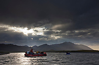 Rafters paddle along the Canning river, Arctic National Wildlife Refuge, Brooks range mountains, Alaska.