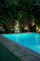 The pool at dusk - underwater lighting combines with subtle spots and tealights in the surrounding garden