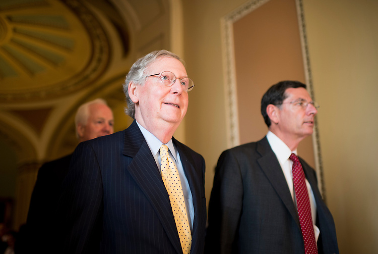 UNITED STATES - JULY 15: From left, Sen. John Cornyn, R-Texas, Senate Minority Leader Mitch McConnell, R-Ky., and Sen. John Barrasso, R-Wyo., walk from the Senate floor to the Old Senate Chamber for the all-Senate Joint Conference on the filibuster on Monday, July 15, 2013. (Photo By Bill Clark/CQ Roll Call)