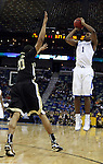 Sophomore guard Darius Miller makes a three-pointer during the second half of UK's second round  win, 90-60 over Wake Forest in the NCAA tournament at New Orleans Arena on Saturday, March 20, 2010. Photo by Britney McIntosh | Staff