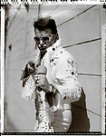 "An Elvis impersonator  poses for a portrait prior to his trying out for the reality talent show ""The Next Best Thing"" in New York March 21, 2007."