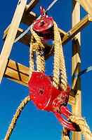 PULLEY<br /> Pulley and Rope<br /> Pulley, mechanical pulling or lifting device, consisting of a wheel (also known as a sheave) mounted on an axis with a rope (also known as a tackle) passing over the circumference.