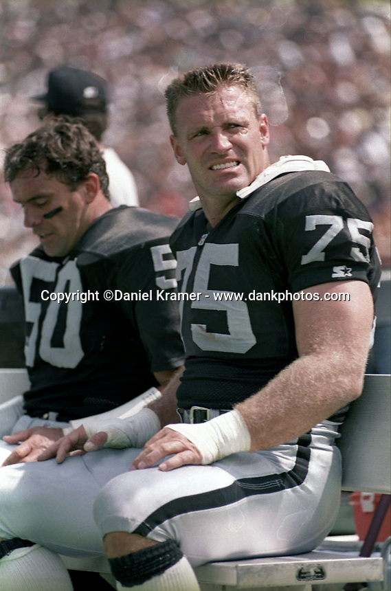 Los Angeles Raiders defensive end Howie Long on the bench in the early 1990s.