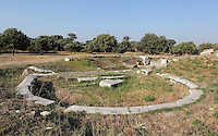 Circular foundations of an unidentified building above the South Gate of Troia VI, probably the principal entrance to the citadel, in the ruins of the Homeric city of Troy, Hill of Hissarlik, Turkey. Troy was a city, both factual and legendary, in northwest Anatolia and was the setting of the Trojan Wars described in Homer's Iliad. Picture by Manuel Cohen