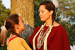 An Native American Lakota Sioux Indian mother talking to her son