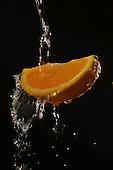 Stock photo of orange being washed