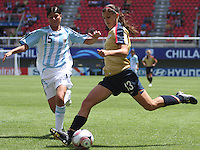 Chile, Chillan:Usa forward Alex Morgan goes for the ball along with Vanesa Santana during the football second match of the Fifa U-20 Women´s World Cup the at Nelson Oyarzún stadium in Chillán , on November 22 2008. Photo by Grosnia/ISIphotos.com