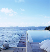The infinity pool overlooks the Caribbean Sea and the outlying islands around Mustique