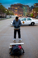 An Arab man  reading Koran and preying near the White House in Washington DC