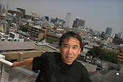 Haruki Murakami, born 1949,  Japanese contemporary fiction author / novelist / essayist. Photographed on the roof of his office,  Tokyo, Japan. 15.07.2004.  Murakami is author of noted books such as 'The Elephant Vanishes', 'Norwegian Wood', 'A Wild Sheep Chase', 'Underground', 'After the quake' and 'Kafka on the Shore'.