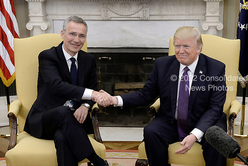 United States President Donald J. Trump shakes hands with Secretary General Jens Stoltenberg of NATO in the Oval Office of the White House in Washington, DC, April 12, 2017.<br /> Credit: Olivier Douliery / Pool via CNP