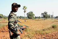 A young policeman watches for potential attack from the Naxalites as voting takes place for the second time at Pandewar village in Dantewada district. During the first polling Naxals came and destroyed the electronic voting machine.