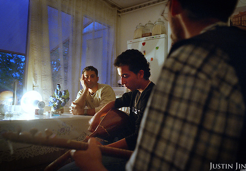 Dutch-Turkish teenager Hakan Dinc plays the sas to his relatives at home in Amsterdam. .Dinc, 16, was born in the Netherlands. His grandparents from his father?s side came from Turkey in 1971, and his mother came in 1987. Dinc feels more Turkish than Dutch, most of his friends are Turkish and he wants to marry a Turkish girl. During his time off he works in his uncle?s grocery store. Later, he wants to have his own shop. Dinc is following a Commerce course at a vocational school in Amsterdam. .Dinc likes music, pool and chilling out. He has a fourteen-year-old sister and a brother aged ten months. .Picture shot in Amsterdam in 2004 by Justin Jin. .