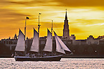 Schooner pride sailboat sailing past the St josephs church steeple downtown charleston south carolina