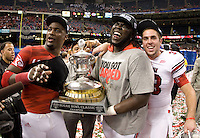 Louisville players celebrate 79th Sugar Bowl champion trophy after winning the game against Florida at Mercedes-Benz Superdome in New Orleans, Louisiana on January 2nd, 2013.   Louisville Cardinals defeated Florida Gators, 33-23.
