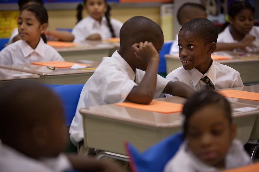Third-grade students Jasir, center and Shamarri, right, during their first day of class at Brownsville Elementary School in Brooklyn, NY on August 15, 2011.