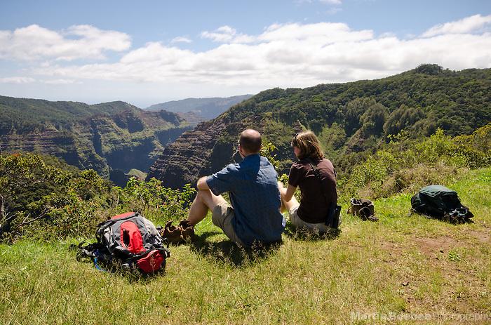 A couple picnicking on the edge of Waimea Canyon, Kauai, Hawaii