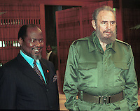 Cuban President Fidel Castro (R) receives the president of Mozambique, Joaquim Chissano (L), in Havana's Palace of the Revolution, October 29, 2001. Chissano is on an official visit to the Caribbean island. Credit: Jorge Rey/MediaPunch