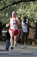 Musa Gwanzura follows behind the Charlottesville 10-miler winner Bill Kabasenche who crossed the finish line with a time of 52.31 Saturday in Charlottesville, Va. Photo/Andrew Shurtleff