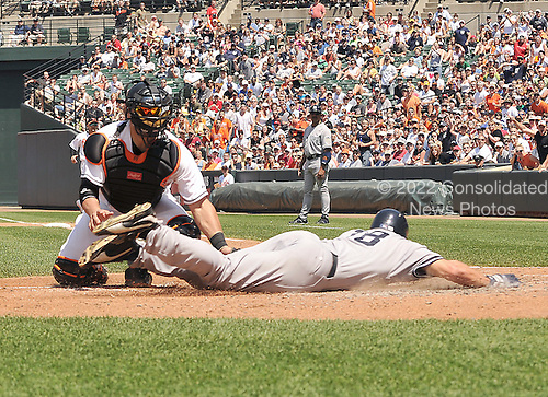 Baltimore, MD - May 26, 2008 -- New York Yankees left fielder Johnny Damon is tagged out at home plate to end the third inning by Baltimore Orioles catcher Ramon Hernandez at Oriole Park at Camden Yards in Baltimore, Maryland on Memorial Day, Monday, May 26, 2008..Credit: Ron Sachs / CNP.(RESTRICTION: NO New York or New Jersey Newspapers or newspapers within a 75 mile radius of New York City)