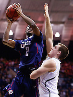 SOUTH BEND, IN - JANUARY 12: DeAndre Daniels #2 of the Connecticut Huskies shoots against Pat Connaughton #24 of the Notre Dame Fighting Irish at Purcel Pavilion on January 12, 2012 in South Bend, Indiana. Connecticut defeated Notre Dame 65-58. (Photo by Michael Hickey/Getty Images) *** Local Caption *** DeAndre Daniels; Pat Connaughton