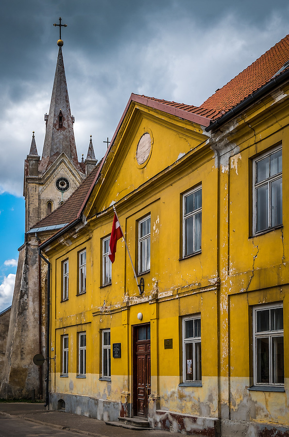 LATVIA, CESIS - CIRCA JUNE 2014: View of  typical street in Cesis, St. John's Church tower in the background.
