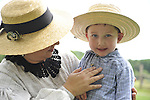 MICHELE WALKER of Coram and her son ROBERT WALKER, 4, wear clothes of American Civil War era while portraying family members of Union soldiers at Camp Scott re-creation, at Old Bethpage Village Restoration, to commemorate 150th Anniversary of American Civil War, on Saturday, July 21, 2012, in Old Bethpage, New York, USA.