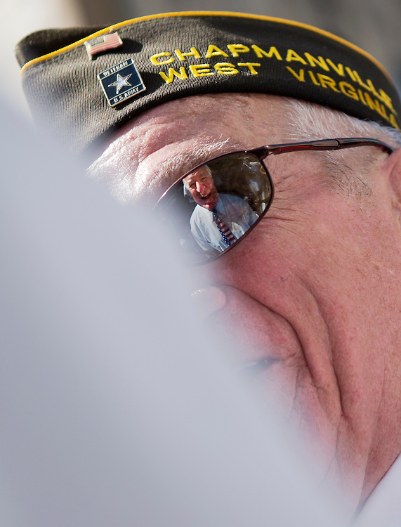UNITED STATES - JULY 5: The reflection of Rep. Nick Rahall, D-W.Va., is seen in the sunglasses of a local veteran as he presnts medals to local veterans at the West Virginia Freedom Festival in downtown Logan, W. Va., on July 5, 2014. (Photo By Bill Clark/CQ Roll Call)