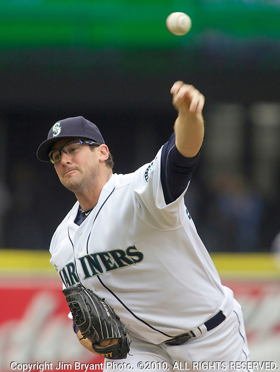 Seattle Mariners' starter Ryan Rowland-Smith pitches against Oakland Athletics' Kurt Suzuki in the second inning of the opening home game at SAFECO Field in Seattle April 12, 2010. The Athletics beat the Mariners 4-0.  Jim Bryant Photo. ©2010. ALL RIGHTS RESERVED.
