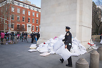 NEW YORK CITY, NY - APRIL 2 : A police officer collects pillows after the International pillow fight event in Washington Square Park on April 2, 2016 in New York City, New York. Thousands of people of all ages attend the free global event in different cities worldwide celebrating the 11th annual International Pillow Fight in New York.  Photo by VIEWpress/Maite H. Mateo